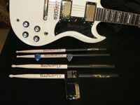 Lisa Crabtree engraved guitars, drumsticks and picks for California-based hard-rock band Buckcherry.