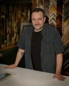 Christian Harwell in the Framing Studio